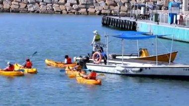 Teacher Learns Children to Ride a Kayaks at the Yaht Marina
