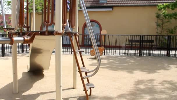 Little Cute Blonde Girl in a Childrens Playground