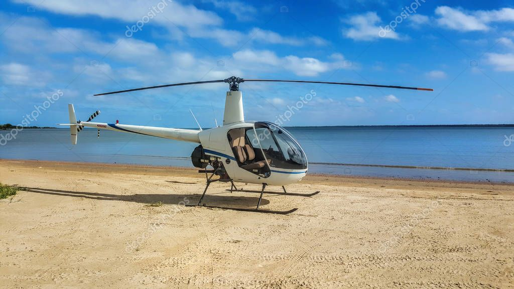 helicopter on the beach on a sunny day