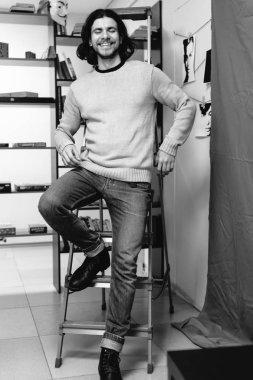 guy posing in a stepladder