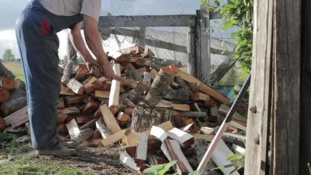 man chopping wood In slow motion