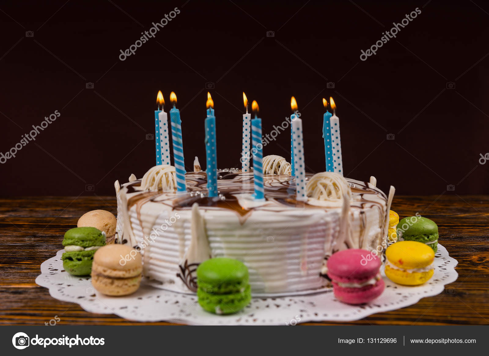 White Homemade Birthday Cake With Lots Of Burning Candles Near D