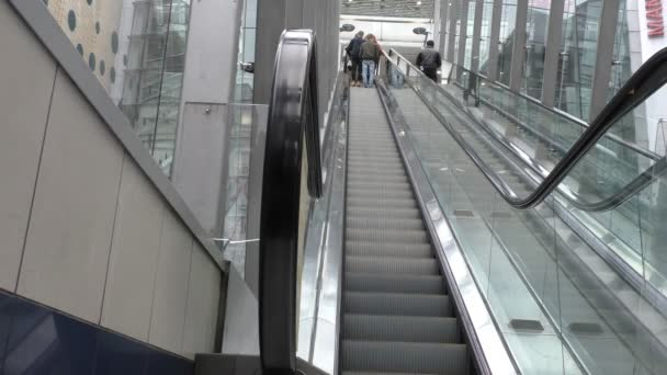 People moving up on escalator