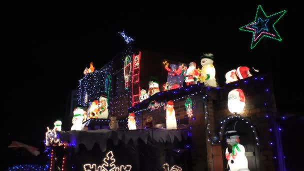 House roof Christmas decorations– stock footage