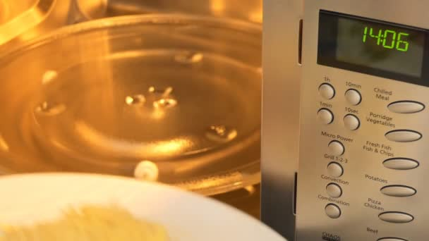 Cooking Jacket Potato In Microwave Oven Stock Video C Opal 170795120