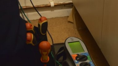 Electrician working with circuit breaker, tester, multimeter at a ...