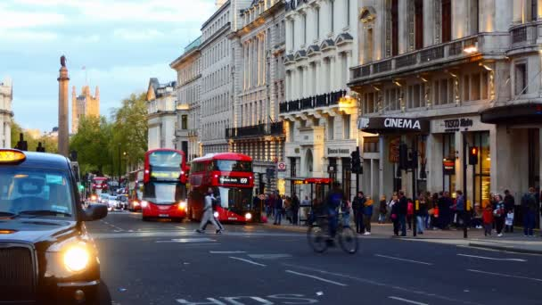 Bicycle rider crossing Regent street in London in the evening