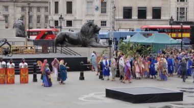 LONDON, ENGLAND, UNITED KINGDOM - APRIL, 2017: Outdoor public reenactment performance showing Jesus Christ passion in the square in the centre center of city. Jesus rides into Jerusalem on a donkey and crowd greet him