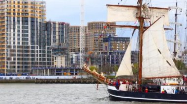 LONDON, ENGLAND, UNITED KINGDOM - APRIL, 2017: Two tall ships sailing along river Thames in Woolwich, London, United Kingdom. Schooner Thor Heyerdahl from Kiel, Germany and barque Artemis from Harlingen, Netherlands