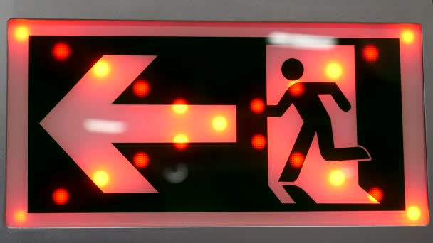 Red arrow and man sign showing direction to the left