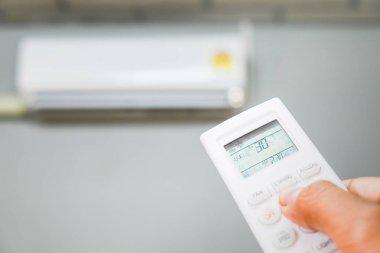 Hand holding air  conditioner remote control temperature stock vector