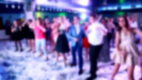 youth dancing in a nightclub to music, background, blurred, copy space