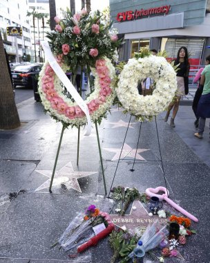memorial wreath laid on Debbie Reynolds Star on the