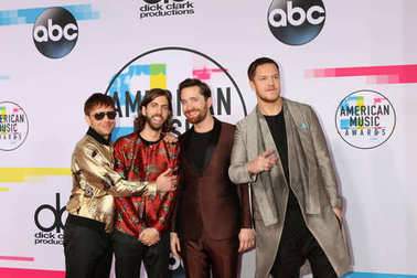 Ben McKee, Daniel Wayne Sermon, Daniel Platzman, Dan Reynolds of Imagine Dragons at the American Music Awards 2017 at Microsoft Theater in Los Angeles, CA