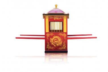 Traditional Chinese culture,Palanquin carrying the bride isolated on white background with clipping path.