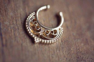Beautiful earrings on wooden background