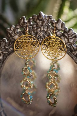 Beautiful earrings with sacred geometry