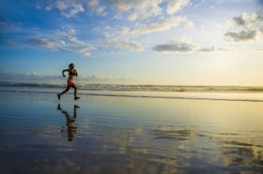 silhouette of young Asian sport runner woman in running workout