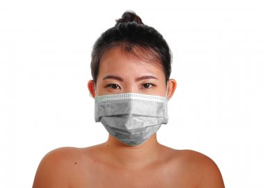 Young beautiful Asian Chinese woman in protective face mask in prevention against Wuhan Coronavirus epidemic outbreak in China in virus transmission and infection concept stock vector