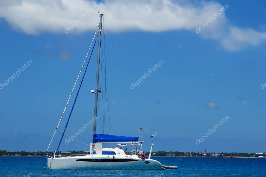 Sailboat anchired near Pangaimotu island in Tonga
