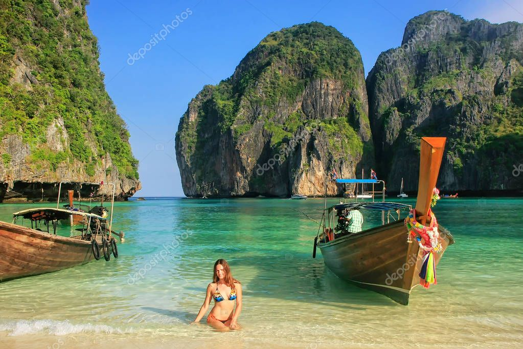 Young woman sitting on the beach at  Maya Bay on Phi Phi Leh Isl