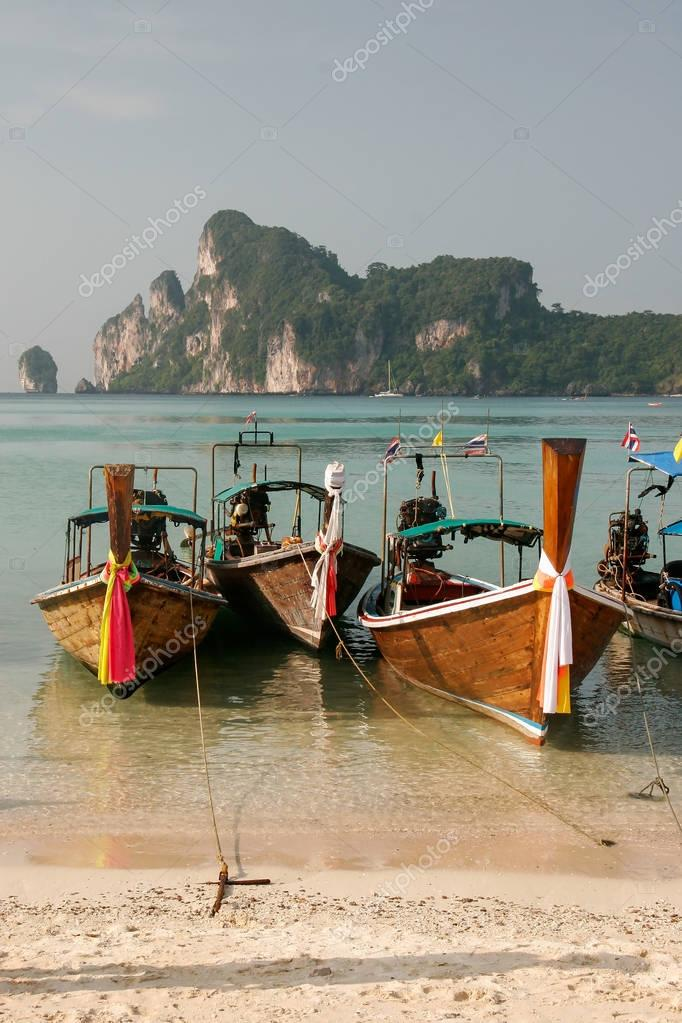 Longtail boats anchored at Ao Loh Dalum beach on Phi Phi Don Isl