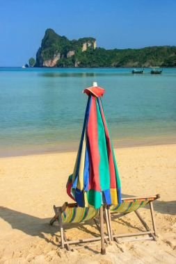 Umrella and sunchairs at Ao Loh Dalum beach on Phi Phi Don Islan