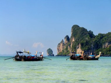 Ao Loh Dalum bay with anchored longtail boats on Phi Phi Don Isl