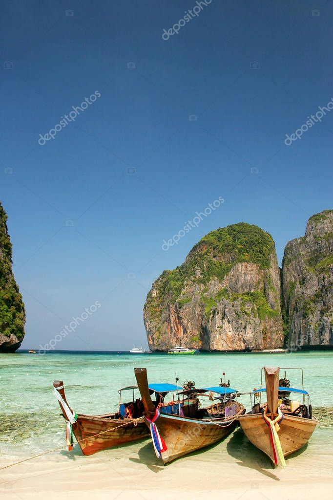 Longtail boats anchored at Maya Bay on Phi Phi Leh Island, Krabi