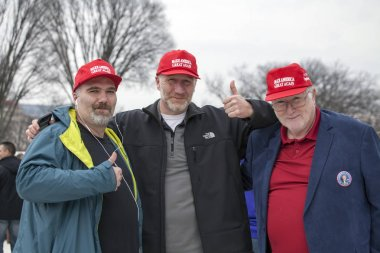 Men with slogan hats during Inauguration of Donald Trump