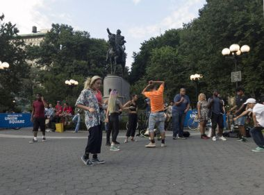 People dancing in front of George Washington Statue in Union Squ