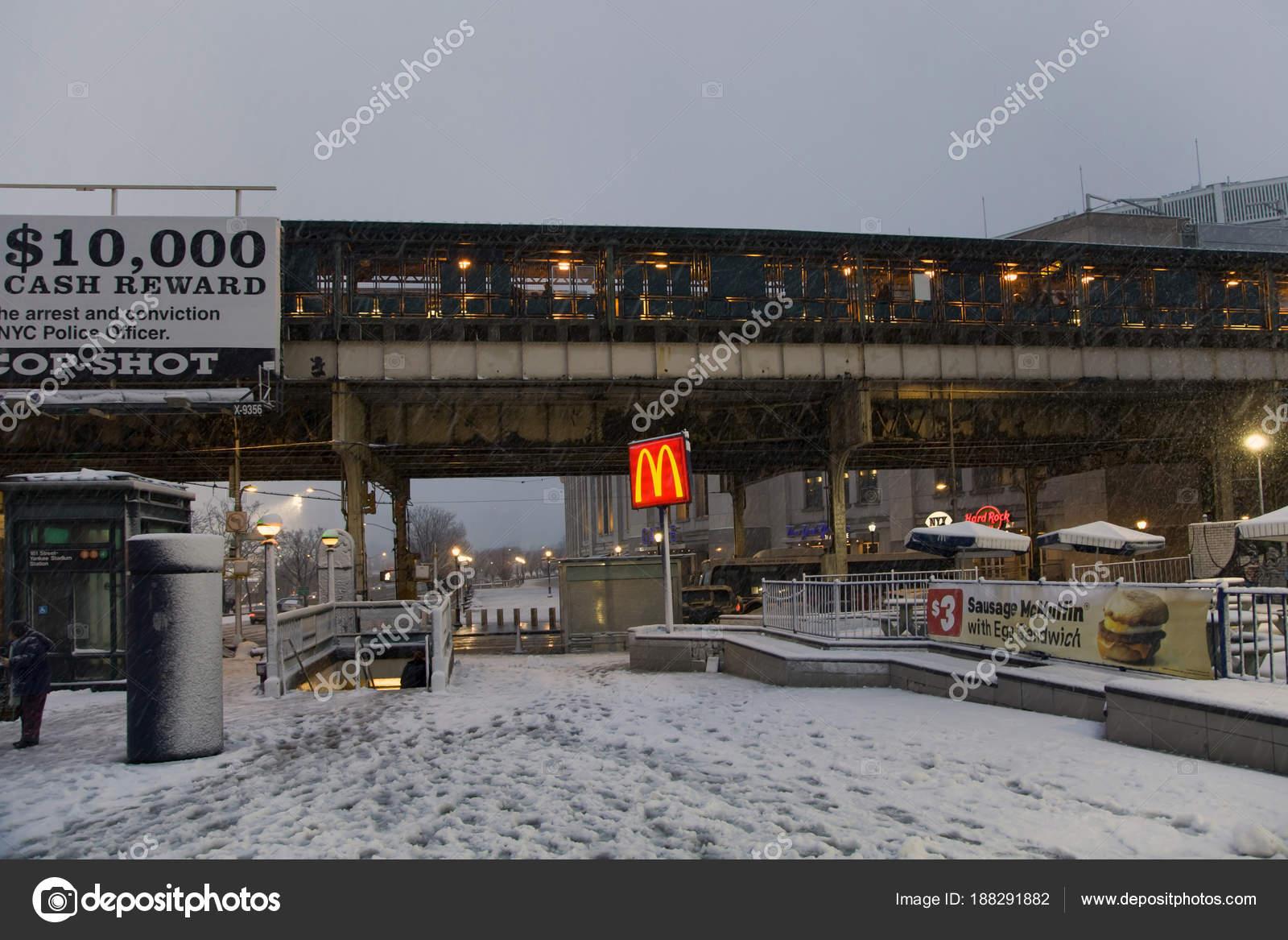 street near yankee stadium subway station during snow storm