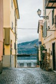 Fotografie view on alban hills between buildings in Castel Gandolfo, Rome suburb, Italy