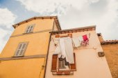 Fotografie low angle view of clothes drying outside building in Orvieto, Rome suburb, Italy