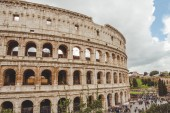 ROME, ITALY - 10 MARCH 2018: ancient Colosseum ruins with crowded square