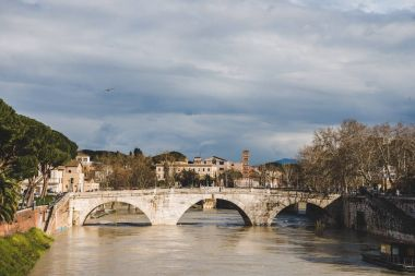 bridge over tiber river on cloudy day, Rome, Italy