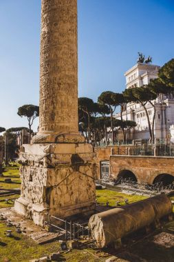 Trajans Column near roman forum ruins, Rome, Italy stock vector