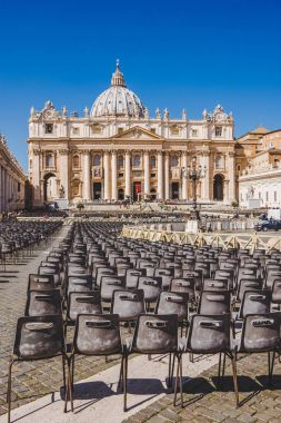 VATICAN, ITALY - 10 MARCH 2018: rows of chairs on St. Peter's square stock vector