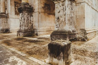 close-up shot of ancient Arch of Constantine, Rome, Italy