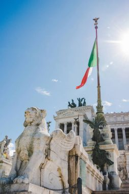 bottom view of beautiful Altare della Patria (Altar of the Fatherland) with italian flag, Rome, Italy