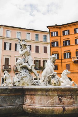 ancient statues on Fountain of Neptune in Rome, Italy