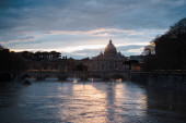 view of St Peters Basilica and buildings in Rome, Italy at evening