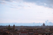 view of St Peters Basilica and buildings in Rome, Italy