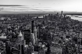 Black and white view of Manhattan downtown skyline and skyscrapers at twilight, New York City, USA.