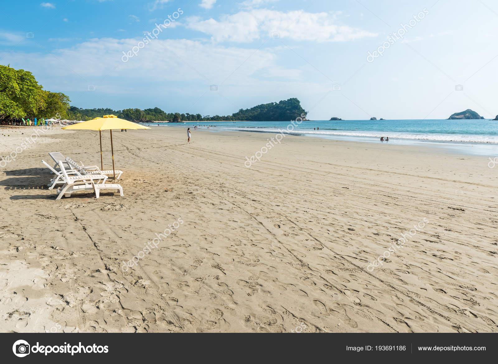 parasol chairs playa espadilla manuel antonio park costa rica