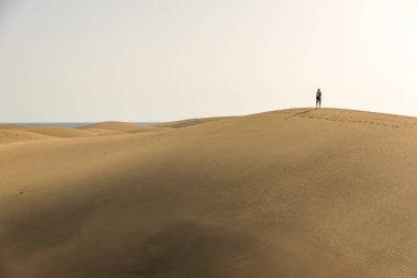 Man walking in the desert of gran canaria, Spain