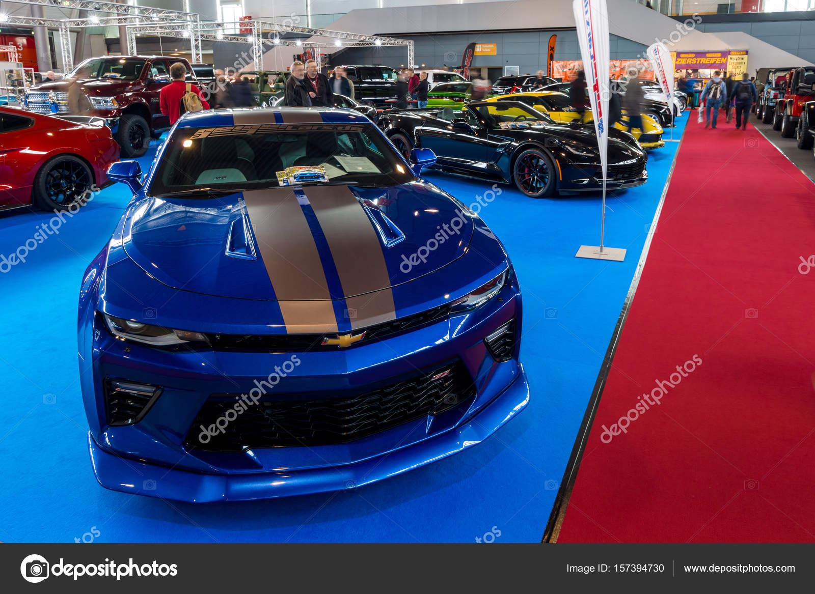 Stand with modern American cars. In the foreground, Chevrolet Camaro ...