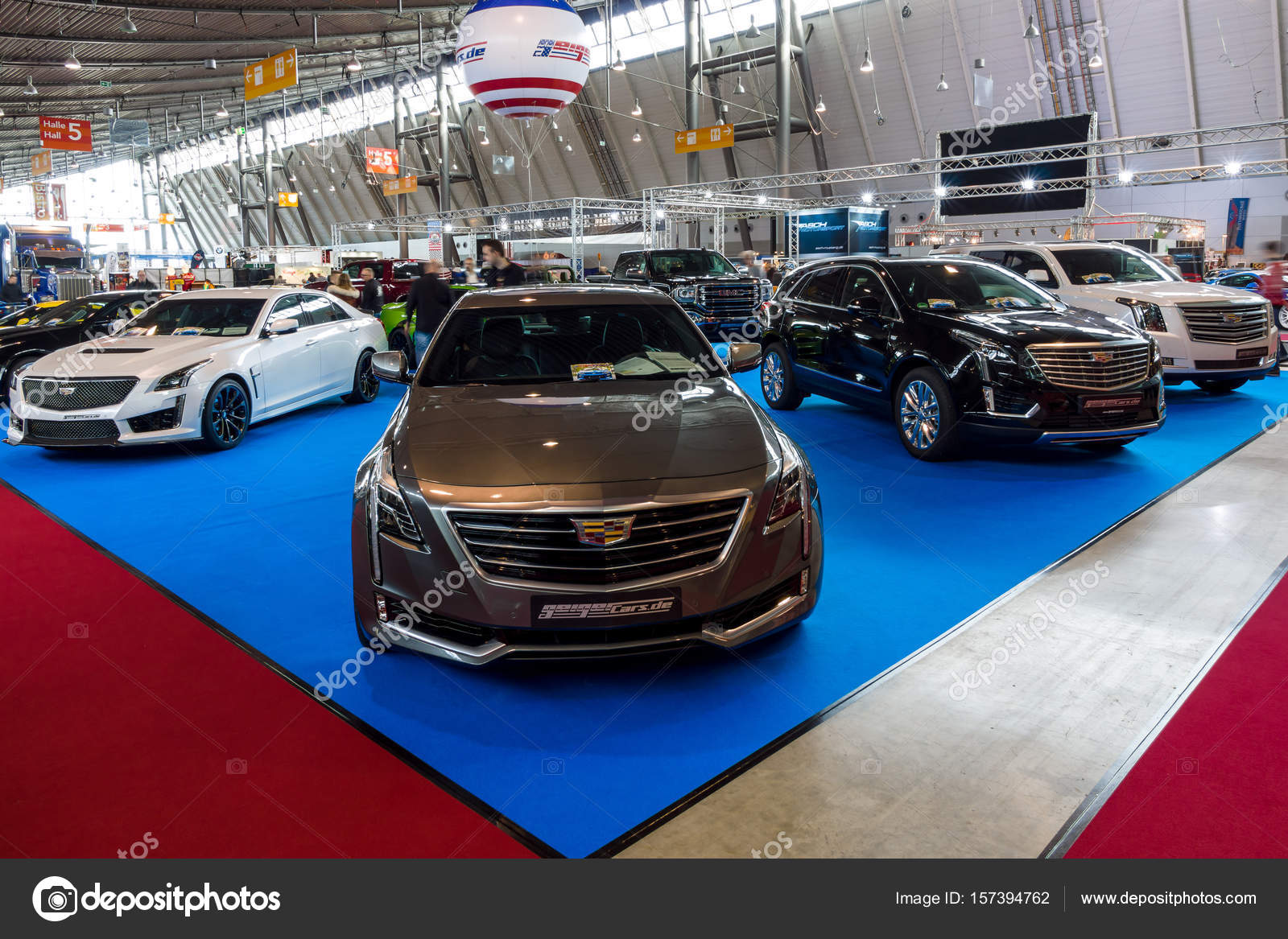 Stand with modern American cars. In the foreground Cadillac CT6 AWD ...