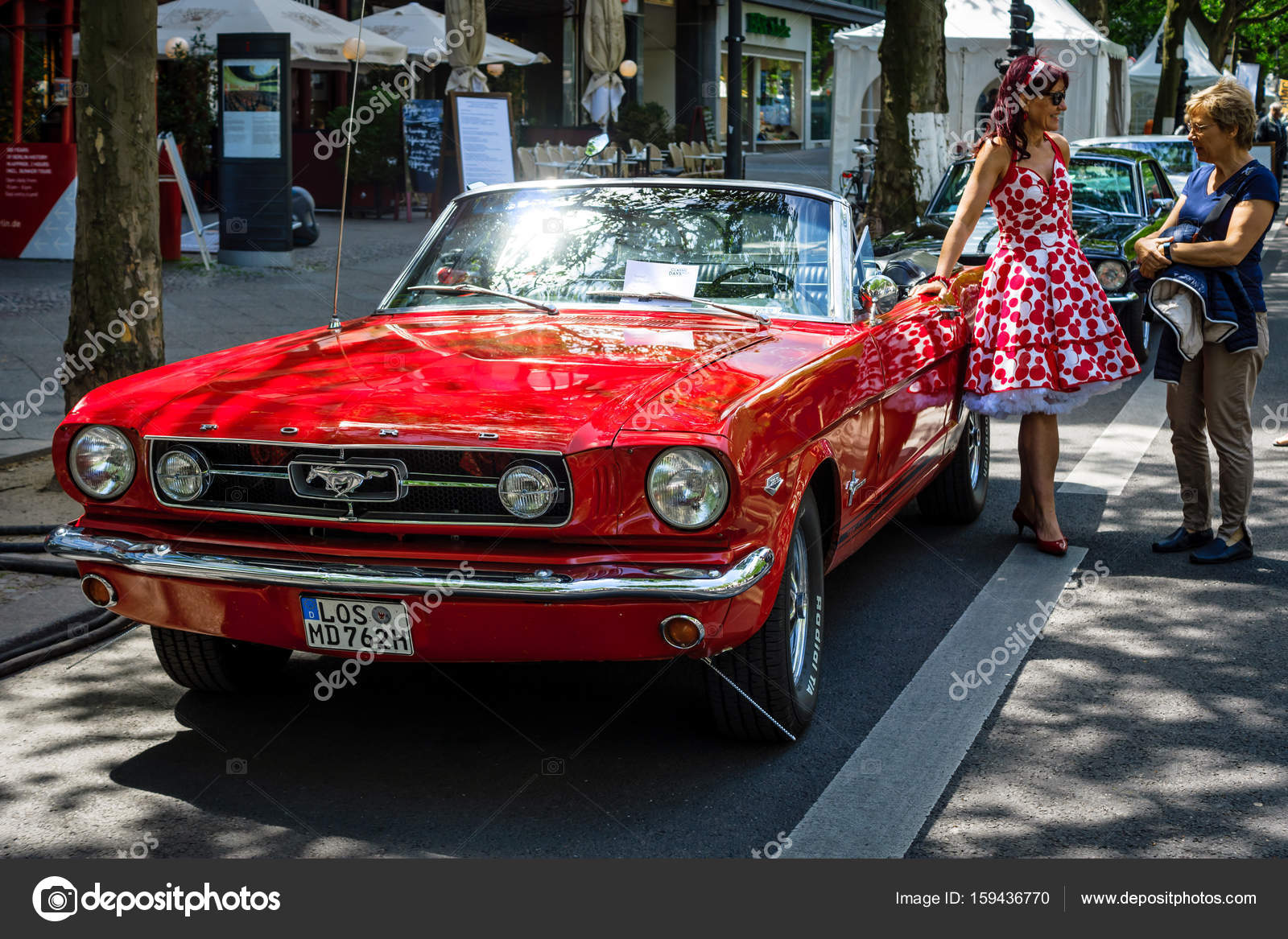 Berlin june 17 2017 muscle car ford mustang convertible 1965 and a woman in a 60s dress classic days berlin 2017 photo by s kohl