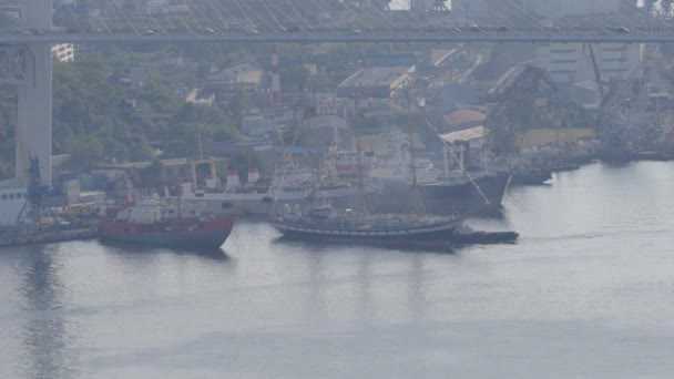 VLADIVOSTOK, RUSSIA - APRIL 8, 2018: Three-masted sailboat entering port for docking.